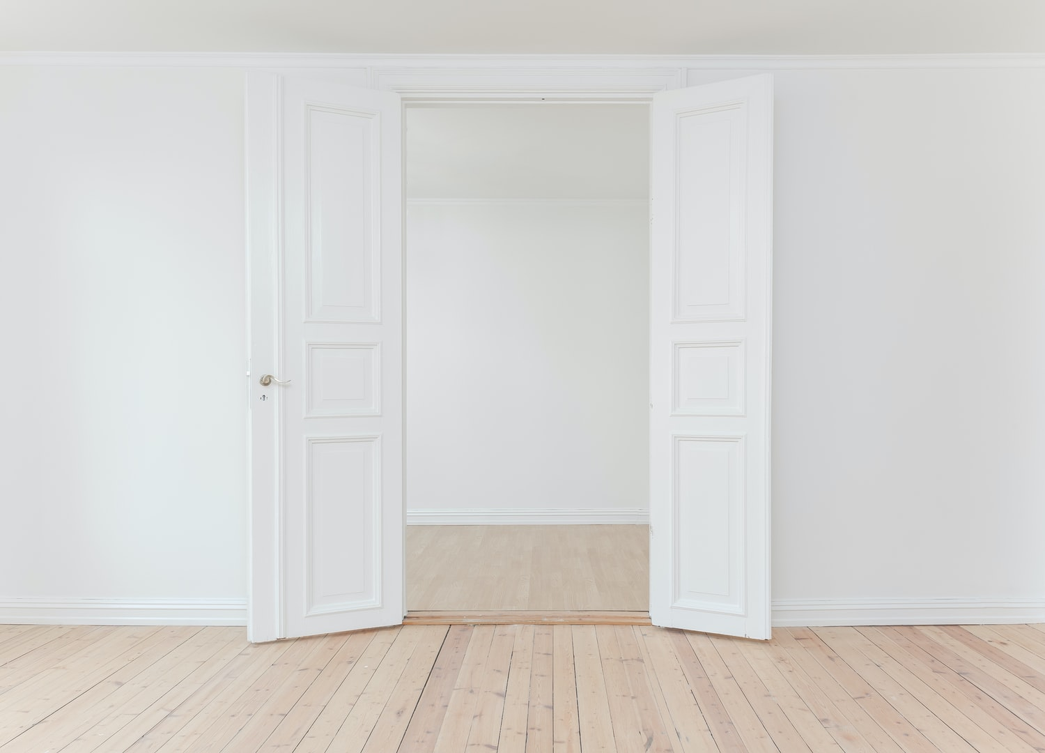 painted white room with double doors